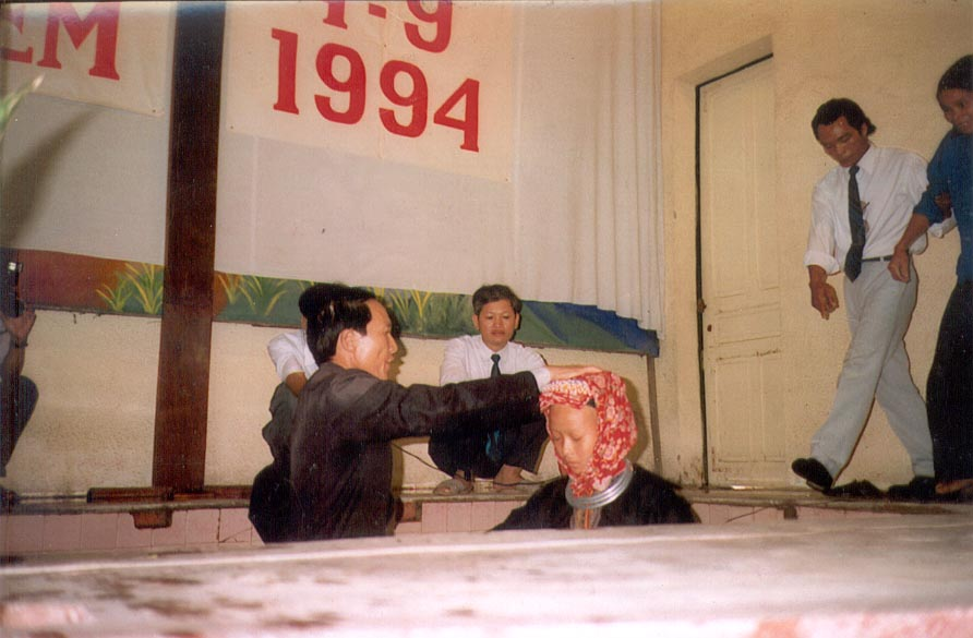 Mien_in_Hanoi_being_baptized_1994